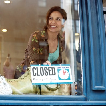 Woman Putting out Closed Sign